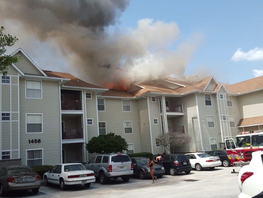 Flames engulf buildings at Tivoli apartments off McCulloch