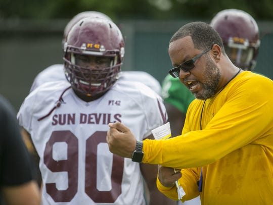 ASU assistant coach Michael Slater shows Tashon Smallwood