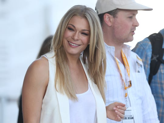 Singer LeAnn Rimes was all smiles before the 98th Indianapolis 500 race at the Indianapolis Motor Speedway Sunday, May 25, 2014.