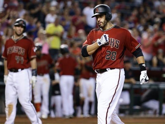 J.D. Martinez crosses home plate after belting a two-run homer in the fourth inning of Wednesday's win over the Braves.