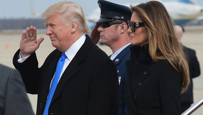 President-elect Donald Trump and wife Melania Trump step off a plane upon arrival at Andrews Air Force Base in Maryland on Thursday.