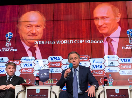 Russian Sports Minister Vitaly Mutko, right, speaks during a press conference on World Cup 2018 issues alongside organizing committee chief executive Alexei Sorokin in Moscow, Russia, Wednesday, April 29, 2015. (AP Photo/Alexander Zemlianichenko)