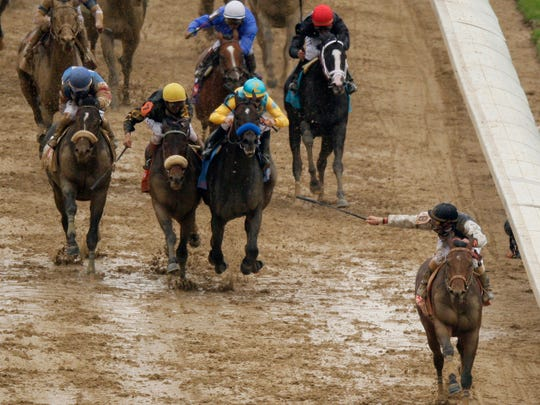 FILE - In this May 2, 2009, photo, Calvin Borel rides Mine That Bird to victory during the Kentucky Derby horse race at Churchill Downs in Louisville, Ky. (AP Photo/Charlie Riedel, File)