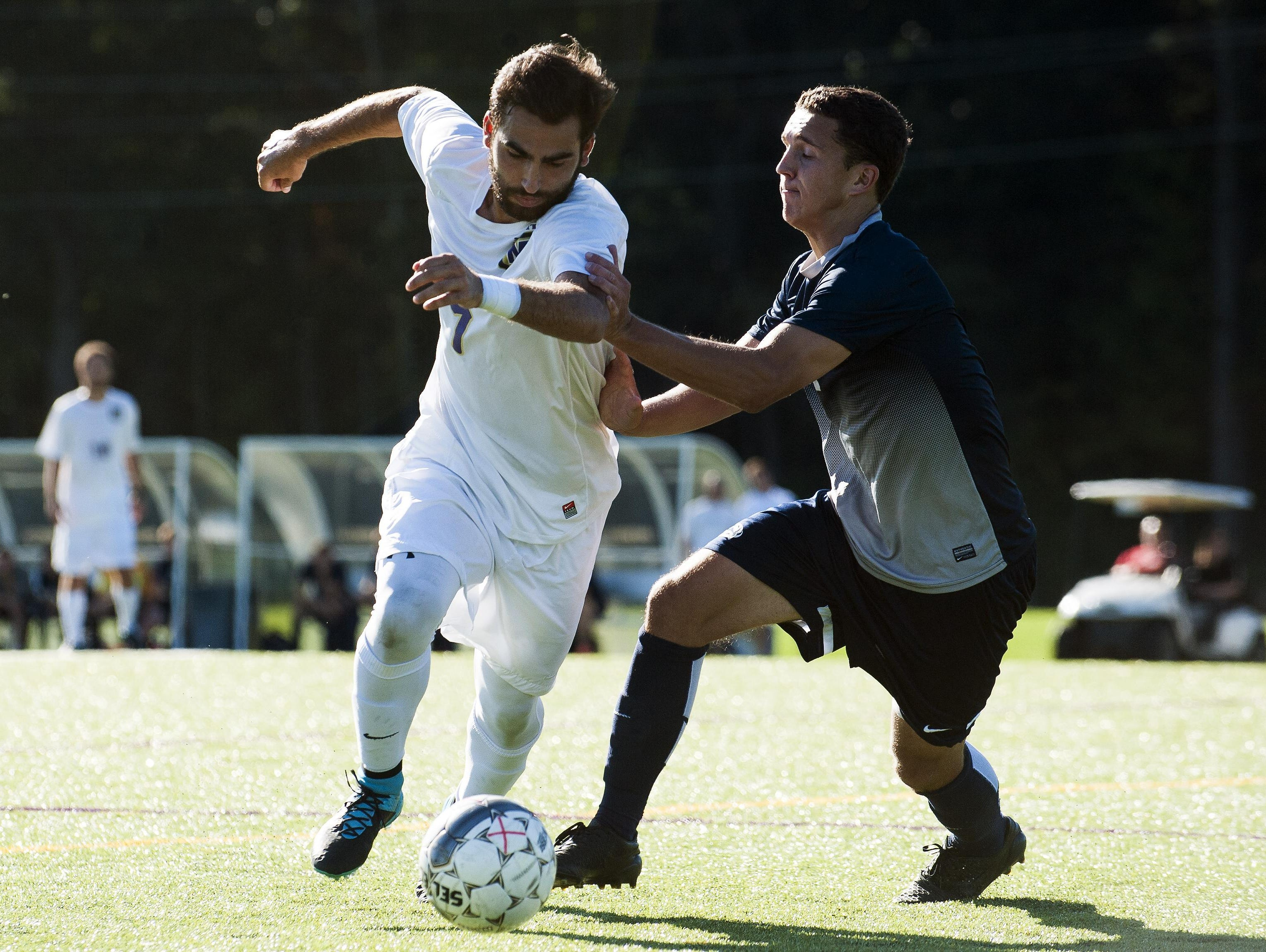 St. Michael's O.J. Rivas (7) runs past St. Anselm's Jack Heintzelman (6) with the ball during the men's soccer game at Duffy Field on Wednesday in Colchester.