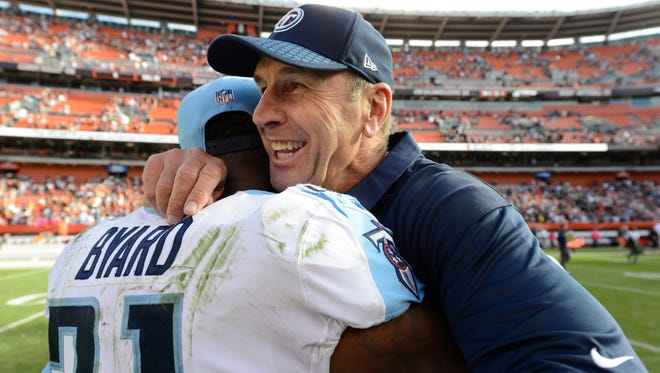 Titans coach Mike Mularkey celebrates with safety Kevin Byard (31) after the win Sunday.