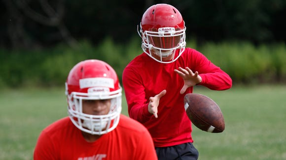 North Rockland quarterback Jeffrey Abrams takes a snap during their first practice at North Rockland High School in Thiells in  on Monday, August 14, 2017.