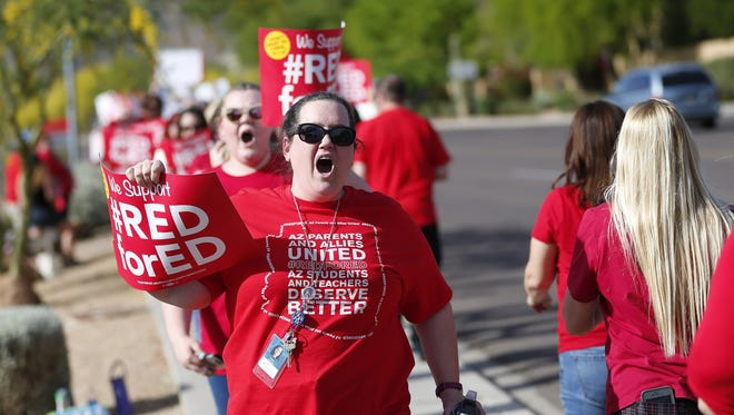 Tawnia McGurthy, second grade teacher at Arrowhead Elementary, and other educators protest outside the KTAR studios in Phoenix on April 10, 2018. Gov. Doug Ducey was making an appearance at the studios.