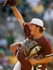 Dowling senior pitcher Colin Lacey (1) celebrates with