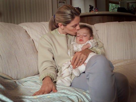 Jill Kelly kisses her son, Hunter, who suffers from Krabbe disease on Oct. 21, 1997.