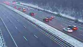 Snow coats the median and shoulders of the wet Taconic State Parkway at Route 35 in Yorktown in this traffic camera image, Dec. 5, 2016.