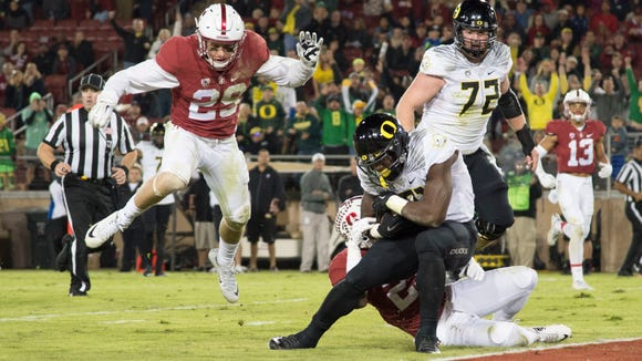 November 14, 2015; Stanford, CA, USA; Oregon Ducks running back Royce Freeman (21) scores a touchdown against the Stanford Cardinal during the third quarter at Stanford Stadium. The Ducks defeated the Cardinal 38-36. Mandatory Credit: Kyle Terada-USA TODAY Sports