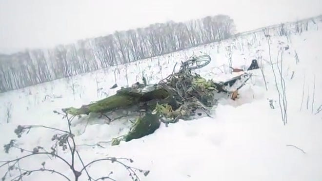 In this screen grab provided by the Life.ru, the wreckage of a AN-148 plane is seen in Stepanovskoye village, about 40 kilometers (25 miles) from the Domodedovo airport, Russia, Sunday, Feb. 11, 2018.
