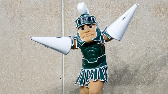 Michigan State mascot Sparty presents to fly on the sideline during the first quarter on Saturday, November 18, 2017, at Spartan Stadium in East Lansing.