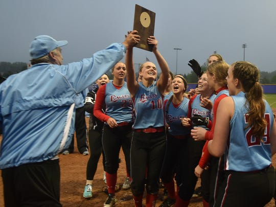 Southern Door coach Pat Delcore hands WIAA Division 2 championship plaque to the team after defeating Marinette, 6-5, Friday, May 27, 2016, in Marinette to advance to sectional playoffs Tuesday against Luxemburg-Casco. Tina M. Gohr/USA TODAY NETWORK-Wisconsin