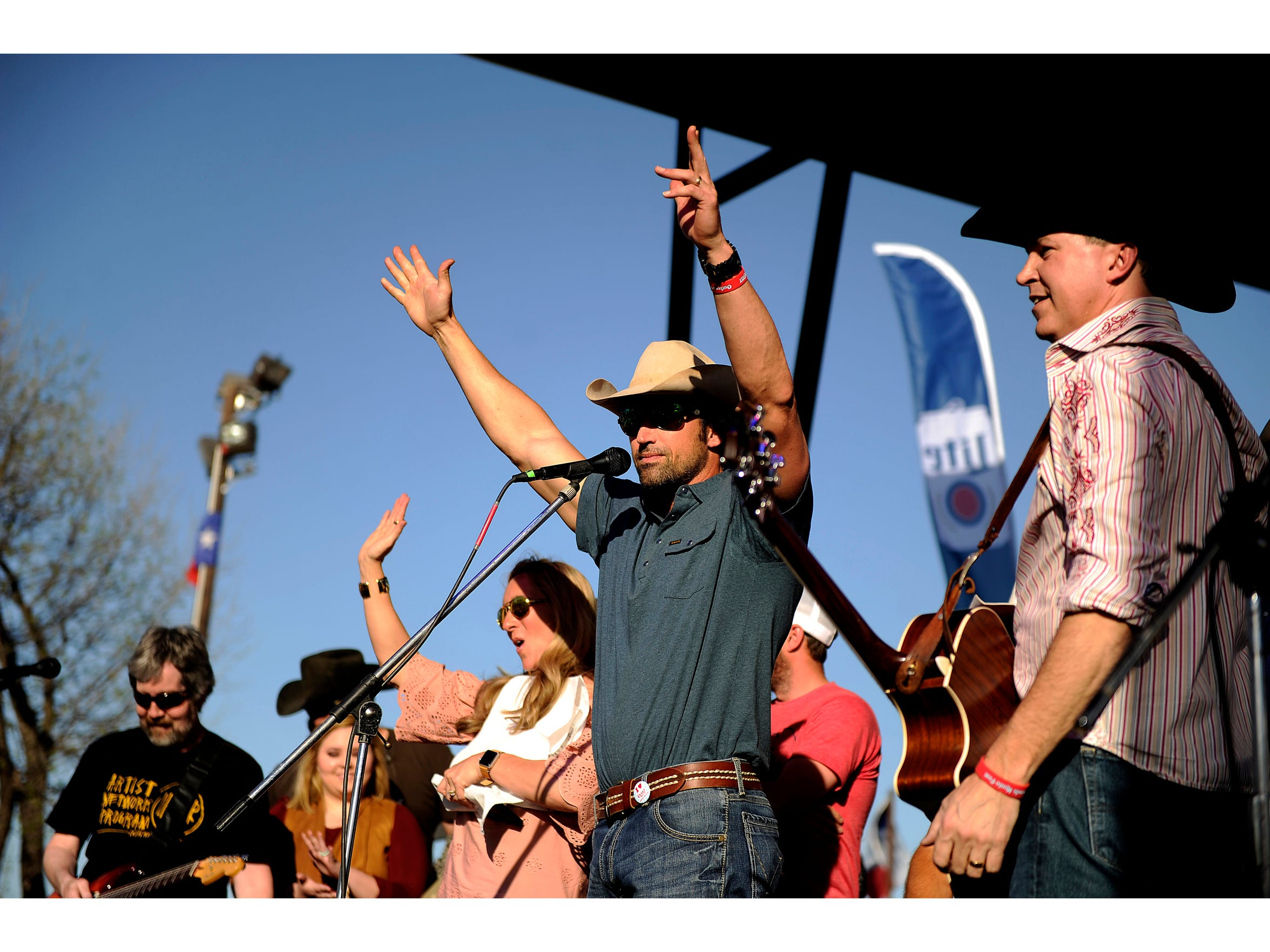 Mark Powell (center) pumps up the crowd before announcing Cooder Graw's Matt Martindale as the 2017 inductee into the Outlaws and Legends hall of fame during the 2017 Outlaws and Legends Music Festival. Martindale performed at the first show in 2011. Cooder Graw is back for the 10th anniversary show.