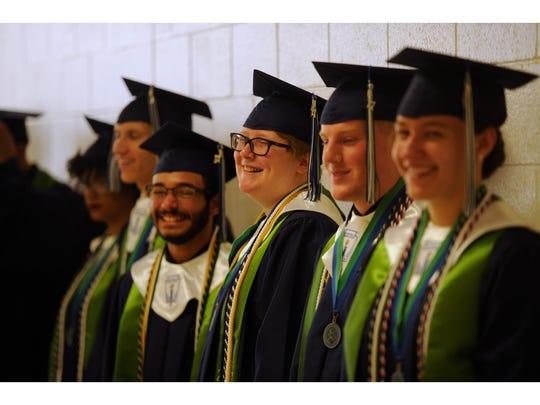 Graduates line up before the ATEMS High School graduation