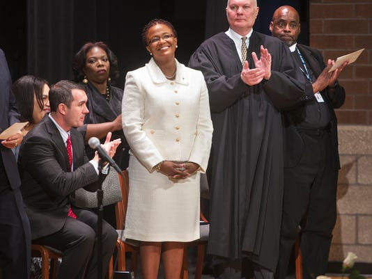 From the left, Eugene DePasquale, auditor general, Mayor Kim Bracey, Judge John S. Kennedy and Dr. Darnell Bowman during Bracey's inauguration to a second term Monday January 6, 2014 in York at William Penn Senior High School.   Paul Kuehnel - Daily Record/Sunday News