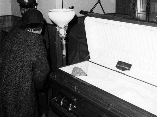 Malcolm X's widow, Betty, takes a last look at the body of her husband before the casket is closed after funeral services at the Faith Temple of God in Christ in New York's Harlem on Feb. 27, 1965.