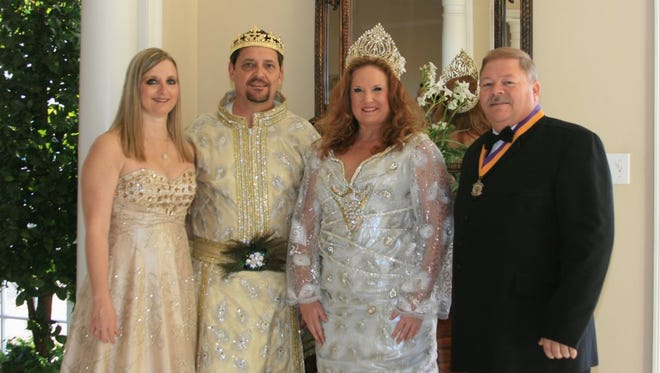 Reigning King Elk XLVIII and Krewe Captain David Brown, second from left, and his wife, Anita, far left; and reigning Queen Elk XLVIII Bonnie Malone, and her husband, King Elk XLV and Exalted Ruler Kevin Malone, greeted guests at the Krewe of Elks' Cocktail Party.