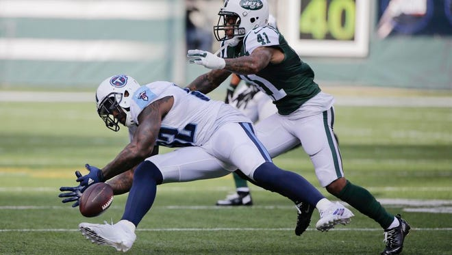 Titans tight end Delanie Walker drops the ball during the first half against the Jets.