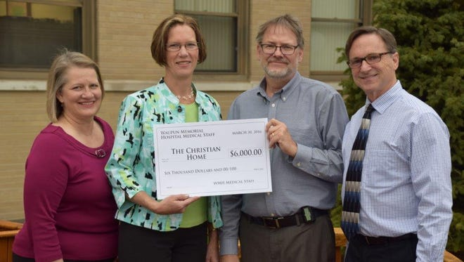 Robert Nagle, D.O. (second from right), and Scott Hansfield, M.D. (far right), Waupun Memorial Hospital Medical Staff leadership, present a $6,000 donation to Barbara Wirkus (second from left), The Christian Home and Rehabilitation Center administrator, and Susan Buwalda (left), The Christian Home and Rehabilitation Center Board of Directors chairperson.