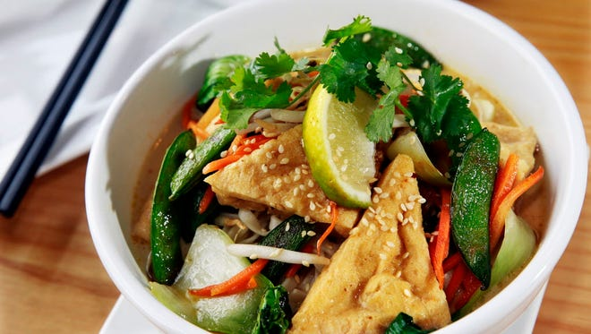 The vegetable laksa at Good City Brewing, 2108 N. Farwell Ave., puts fried tofu, vegetables and egg noodles in a curry coconut broth.