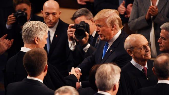 President Trump greets on Jan. 30, 2018.