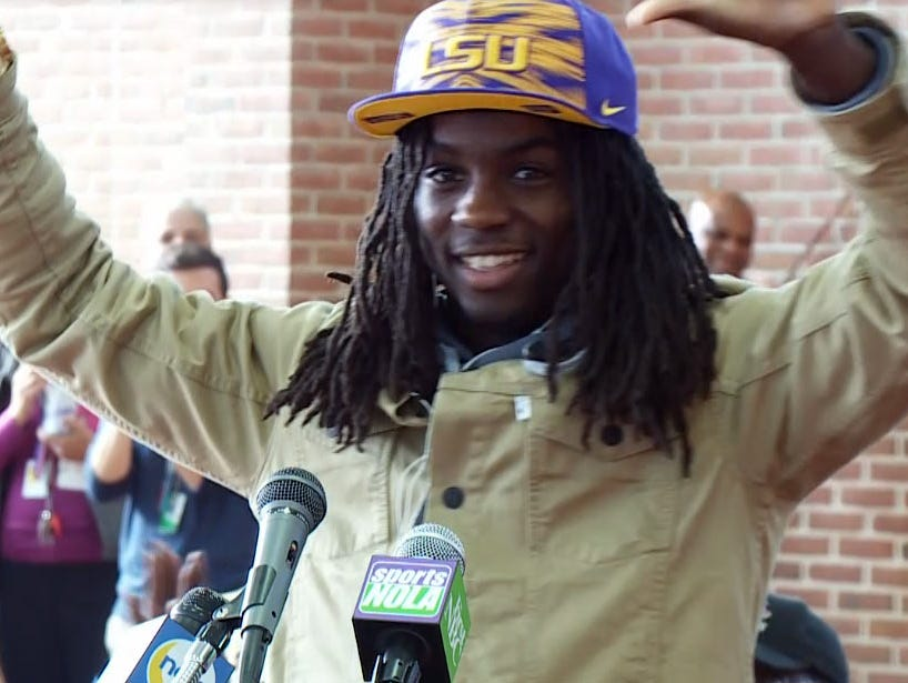 Donte Jackson raises his hands in triumph after signing with LSU on National Signing Day.