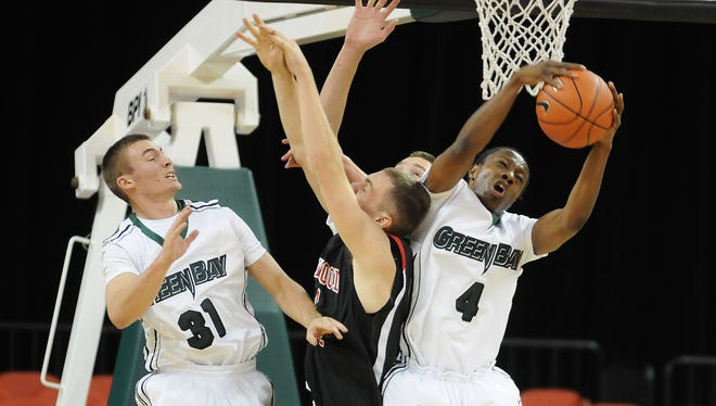 Former UWGB guard Steve Baker, right, loves playing in the Holy Cross basketball tournament.