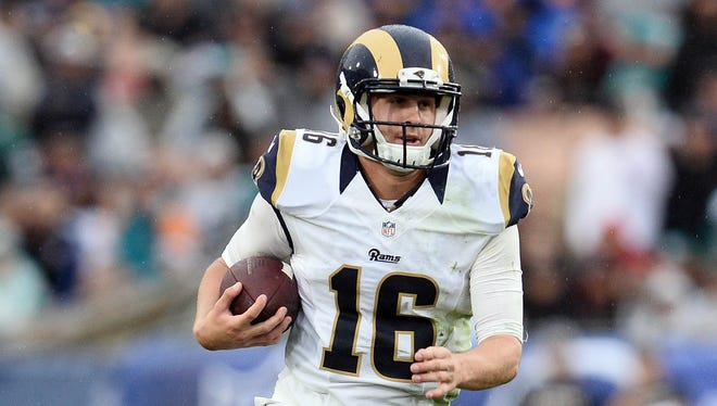 Los Angeles Rams quarterback Jared Goff (16) runs the ball against the Miami Dolphins during the second half at Los Angeles Memorial Coliseum.