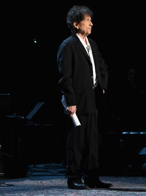 Honoree Bob Dylan walks onstage at the 25th anniversary MusiCares 2015 Person Of The Year Gala honoring Bob Dylan at the Los Angeles Convention Center on Feb. 6, 2015 in Los Angeles.. The annual benefit raises critical funds for MusiCares' Emergency Financial Assistance and Addiction Recovery programs.