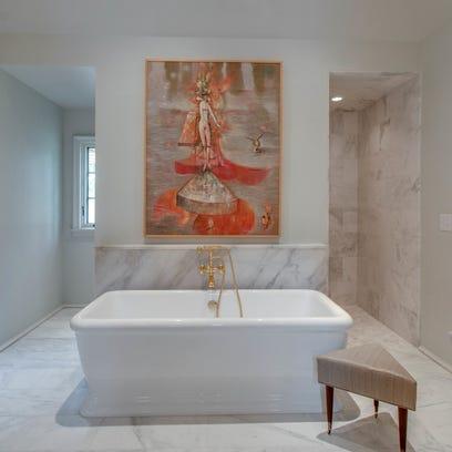 The master bath has a heated floor in Turkish Carrara