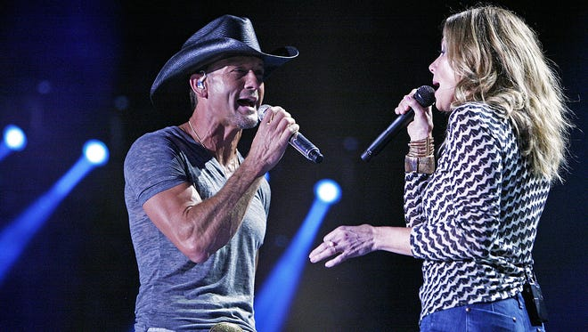 Tim McGraw performs with his wife Faith Hill during the CMA Fest at LP Field June 5, 2014, in Nashville, Tenn.