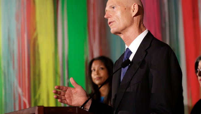 Gov. Rick Scott speaks during a news conference at Wynwood Walls, Monday, Sept. 19, 2016, in the Wynwood neighborhood of Miami. (AP Photo/Lynne Sladky)