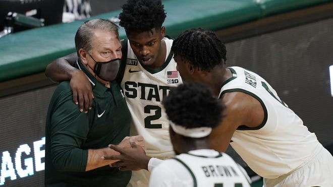 Michigan State coach Tom Izzo talks to guard Rocket Watts (2) and forward Aaron Henry during the second half of the team's NCAA college basketball game against Detroit Mercy, Friday, Dec. 4, 2020, in East Lansing, Mich.