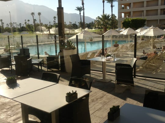 The deck of Mira Bar offers this view of the Double Tree pool and valley mountain.