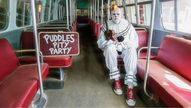 Puddles travels the world sharing his infectious Pity Party.