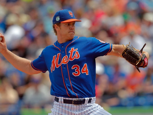 File - In this March 24, 2017, file photoNew York Mets starting pitcher Noah Syndergaard (34) works in the first inning of a spring training baseball game against the Houston Astros Friday, March 24, 2017, in Port St. Lucie, Fla. If recent history is any indication, Syndergaard could be in for a low-scoring duel Monday, April 3, 2017, when he makes his first opening day start against Julio Teheran and the Atlanta Braves. (AP Photo/John Bazemore, File)