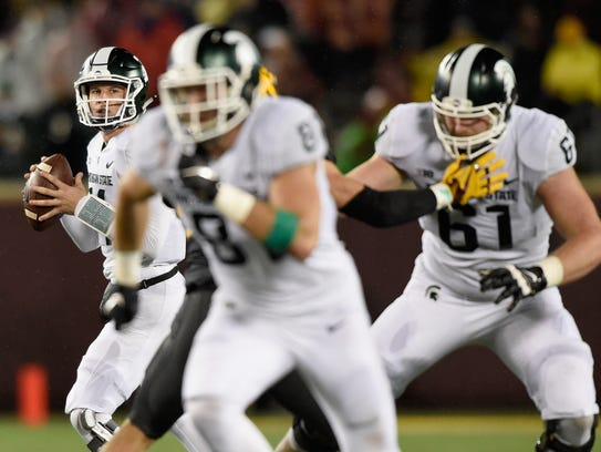Brian Lewerke has led the Spartans with his leg and,