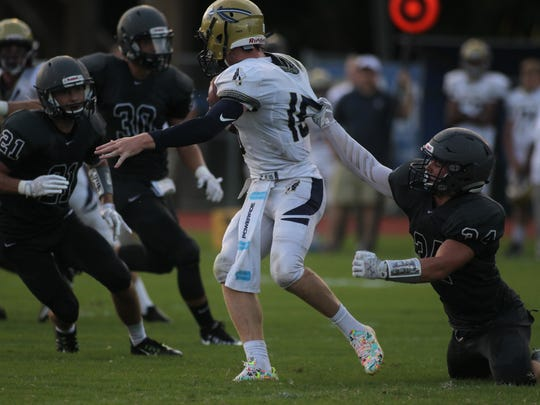 Maclay's AJ Miller hangs on for a sack of Aucilla Christian