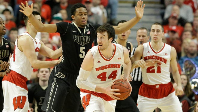 Wisconsin's Frank Kaminsky (44) looks to pass under pressure from Purdue's Basil Smotherman (5) in the first half of an NCAA college basketball game in the semifinals of the Big Ten Conference tournament in Saturday in Chicago.