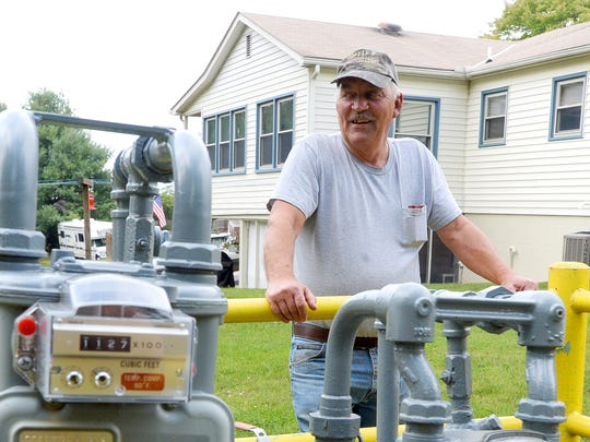 Steve Doyle stands near the tap over Columbia Pipeline Group's natural gas pipeline alongside his Augusta County home near Raphine on Monday, Oct. 1, 2014. The tap helps provide natural gas to his home.