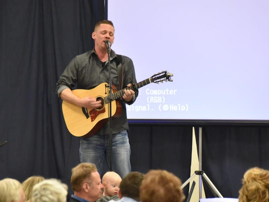 Keynote speaker Chad Bramlee plays for the crowd at the Boys and Girls Clubs of Mason Valley's Youth of the Year Awards Banquet last Saturday in Yerington.