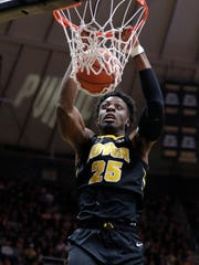 Iowa forward Tyler Cook (25) dunks against Purdue during the first half of an NCAA college basketball game in West Lafayette, Ind., Thursday, Jan. 3, 2019. (AP Photo/Michael Conroy)
