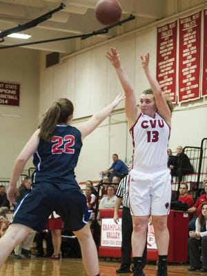 CVU's Marlee Gunn (13) shoots the ball during the girls basketball game between the Mount Anthony Patriots and the Champlain Valley Union Redhawks on Saturday afternoon.