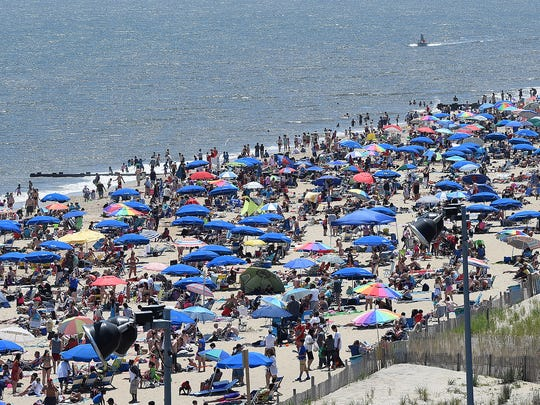 Great weather brought a huge crowd to Rehoboth Beach on Memorial Day weekend 2015, despite the cold water and wind which kept most from entering the ocean.  Parking was at a premium with crowds strolling the boardwalk enjoying the picture perfect day.
