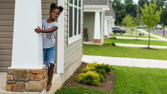 Kamaya Smith looks off the porch of her aunt Lisa Geraci's new home on Melrose Court in Vineland on Tuesday, August 2.