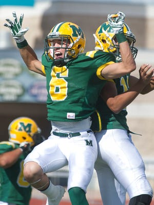 Mayfield's Isaac Vance celebrates his 51 yard touchdown run Saturday afternoon against Carlsbad at the Field of Dreams.