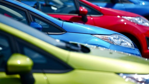 Cars lined up for sale.