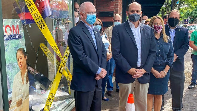 U.S. Rep. Tom Reed, R-Corning, spoke Wednesday at a press conference he called to discuss an incidence of vandalism at his Market Street campaign office, surrounded by his wife Jean, Corning Mayor Bill Boland, Assemblyman Phil Palmesano, R-Corning, and other supporters.